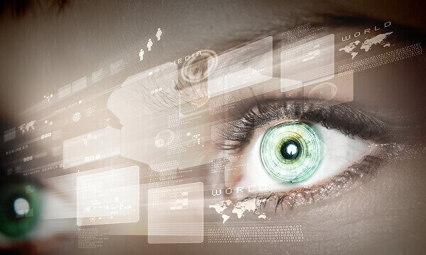 Eye viewing digital information represented by circles and signs.